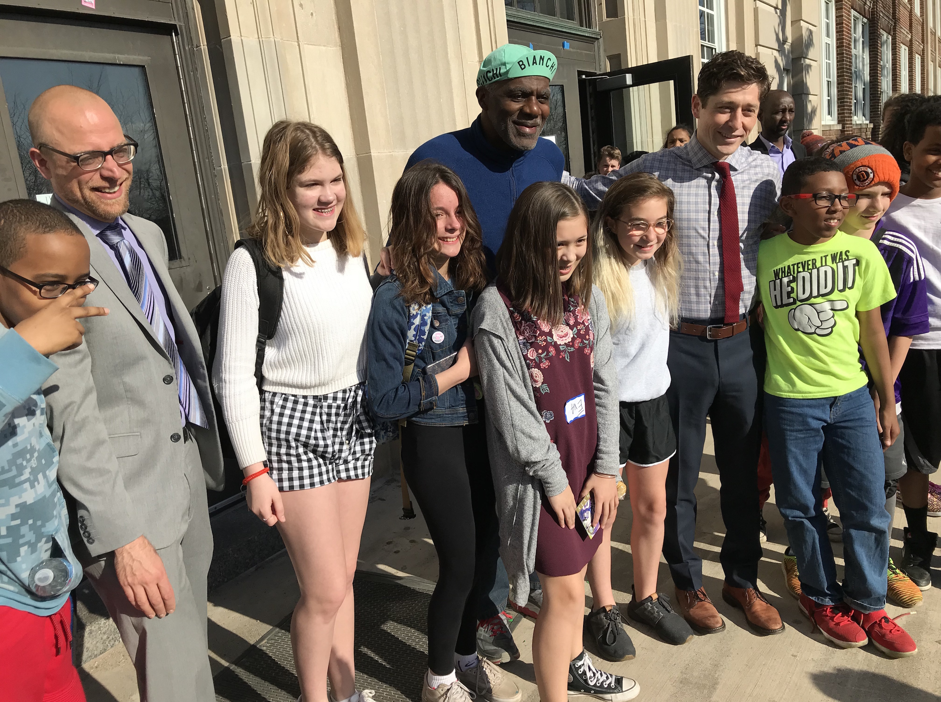 Ward 11 City Council Member Schroeder, Justice Alan Page and Mayor Jacob Frey pose with students before the start of the school day Friday.