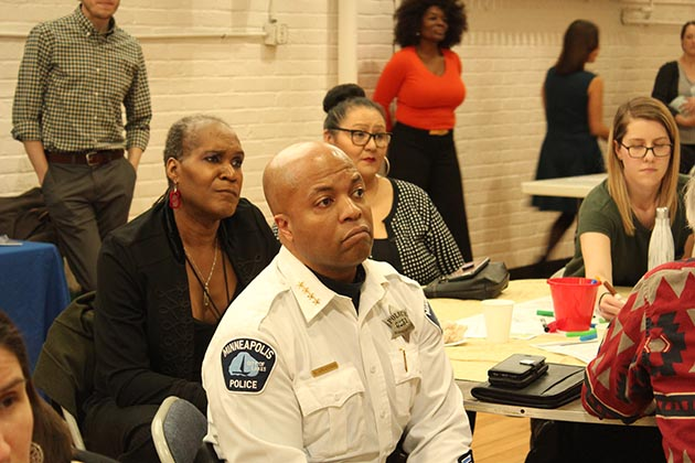 City Council Vice President Andrea Jenkins, left, and Police Chief Medaria Arradondo listened from the audience as activists took over a public safety forum. Photo by Dylan Thomas