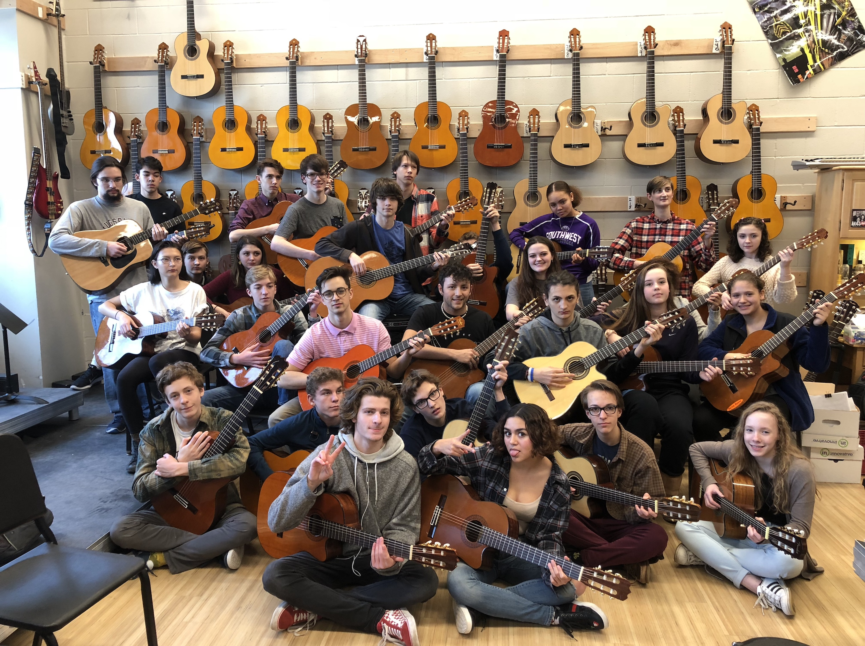 Students in Ruth LeMay's guitar orchestra at Southwest High School pose for a group photo. Photo courtesy Ruth LeMay