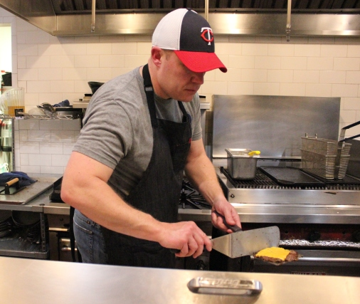 Brian Daniels cooks at a Tap Society pop-up.