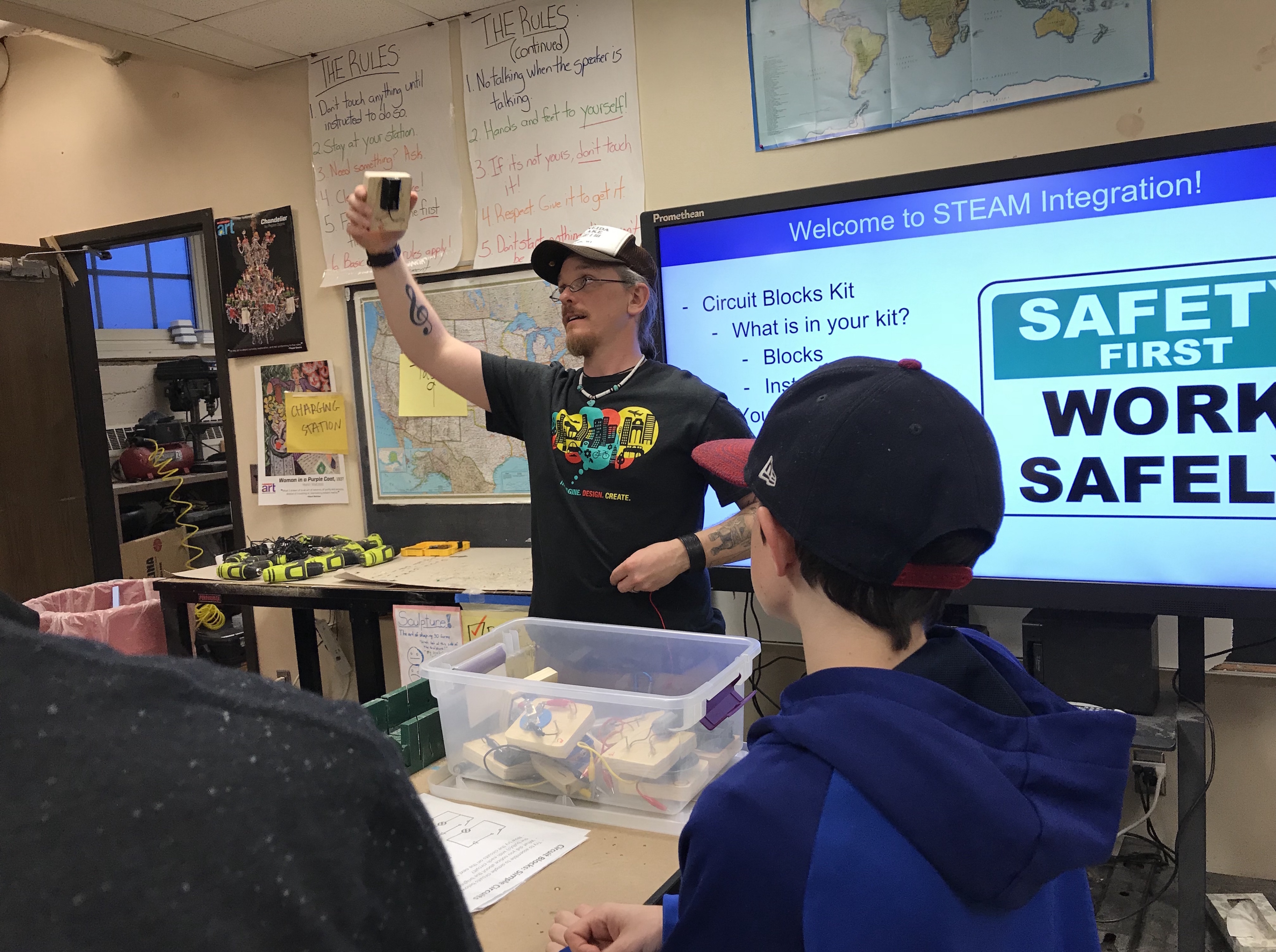 Justice Page Middle School science teacher Travis Koupal provides instructions for an activity in the school's maker space.