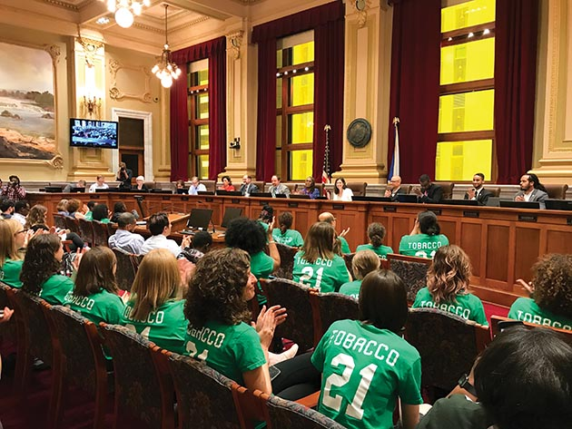 Supporters of the ordinance wore green T-shirts to the City Council meeting. Photo by Sony Chechik