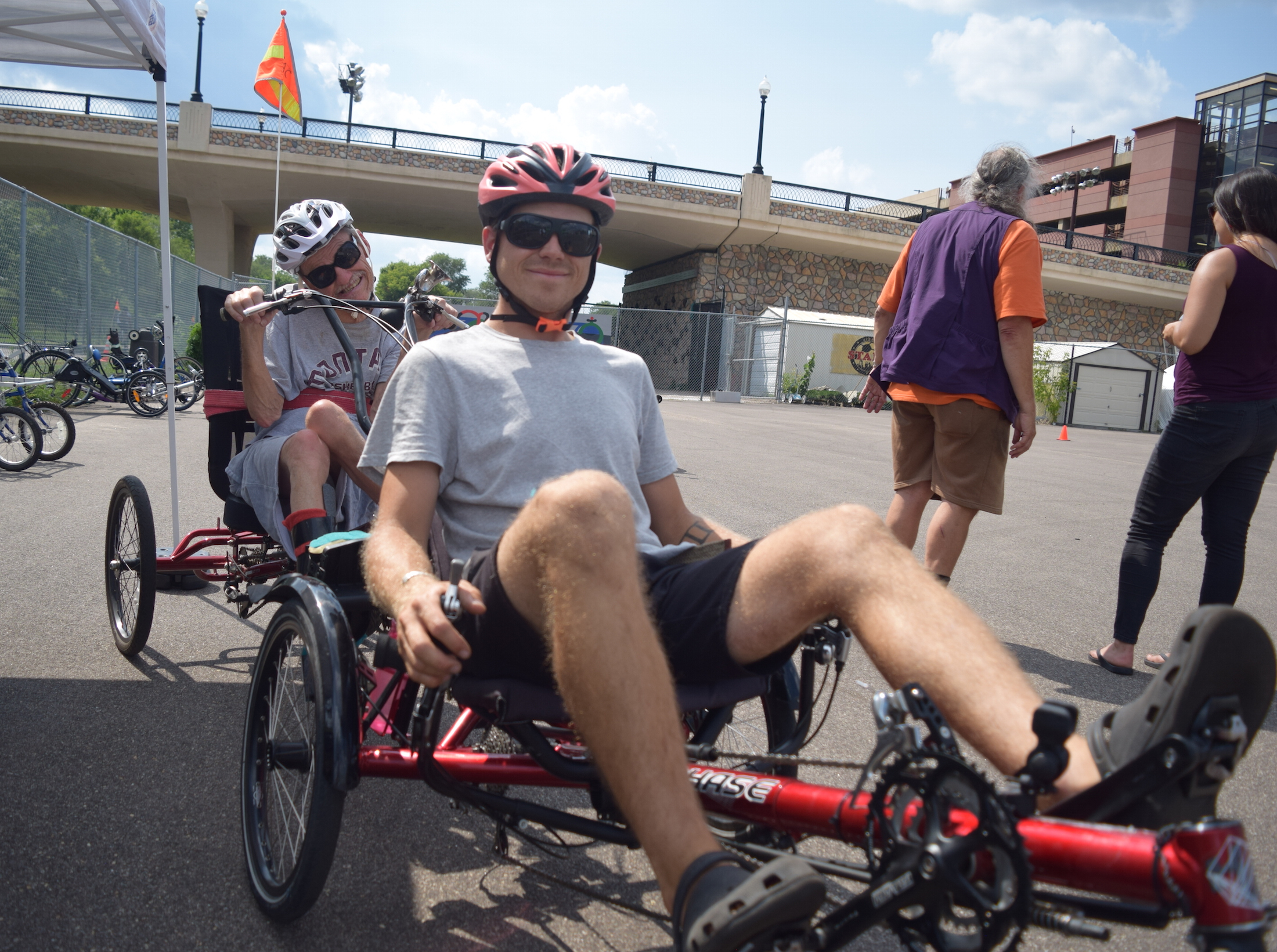 Twin Cities Adaptive Cycling co-founder Tommy Dixon and program participant Robert Gregory prepare for a ride on the Midtown Greenway. Submitted photo courtesy Bill Belknap, Hennepin County Public Health