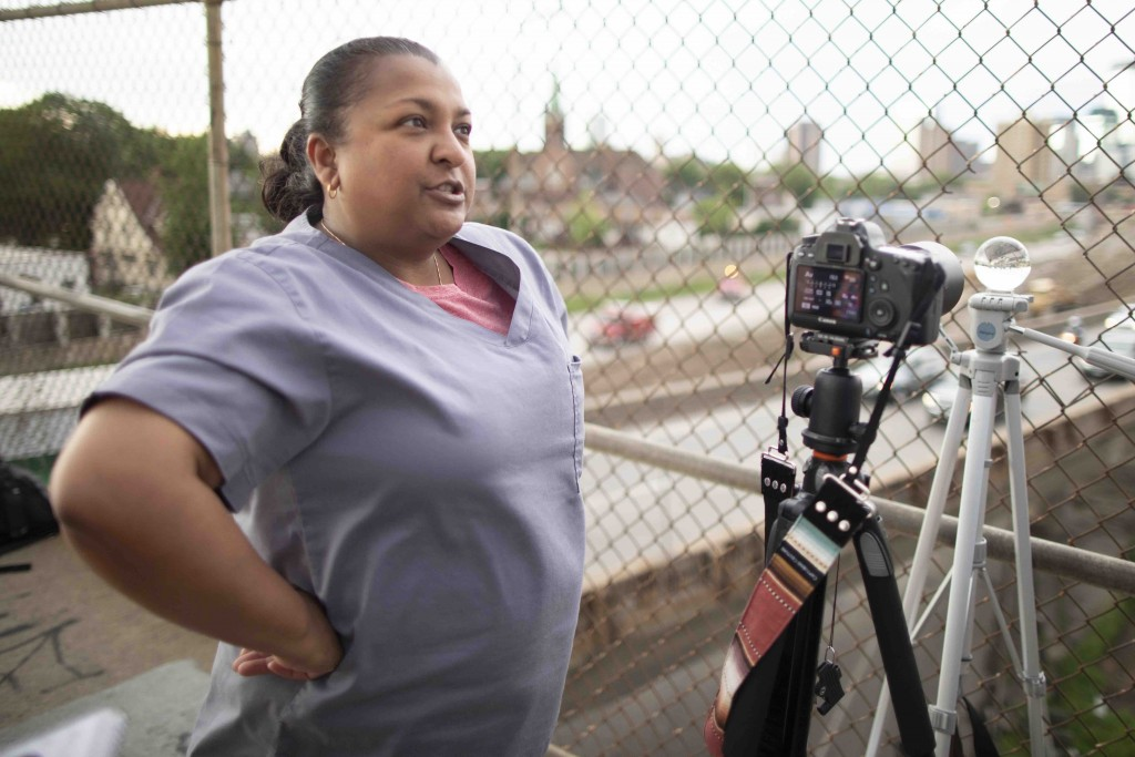 """""""The guy that runs the (Minneapolis Community Education) photography program usually brings his class up here because it's iconic. It's Minneapolis. You've got the lights. You've got the trails,"""" said Asha Lalla, noting she's visited the 24th Street pedestrian bridge with classes several times."""