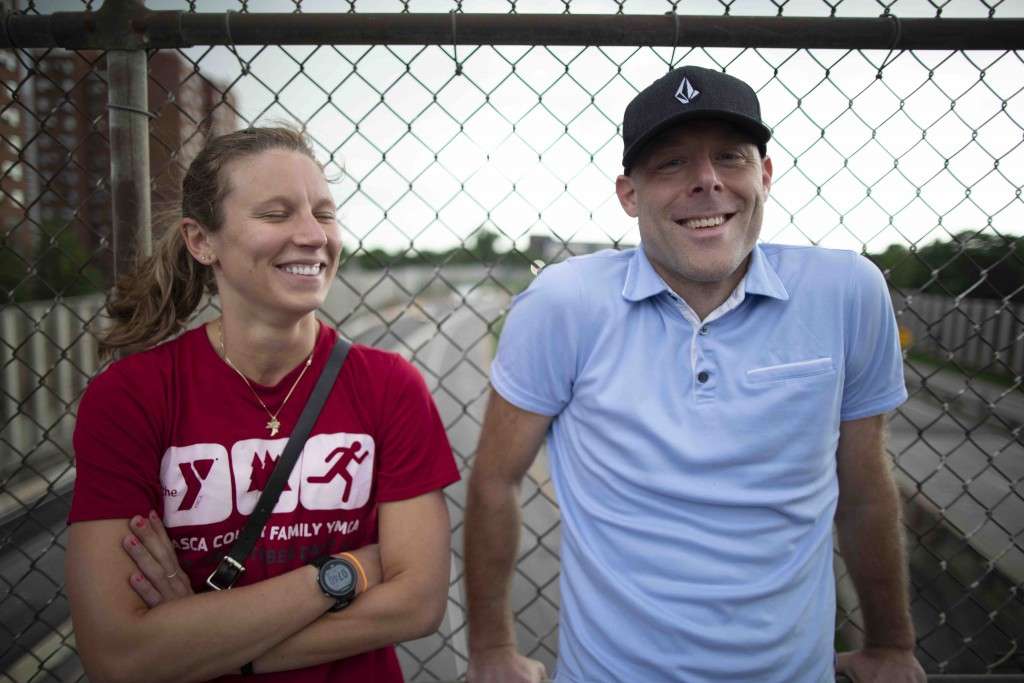"""Drew Dornbusch visited the 24th Street pedestrian bridge with Savannah Kent, a Duluth resident who wanted to see the bridge before it closed. """"It's kind of funny, the photo thing… she's very big into social media and was posting everything on Instagram and Snapchat, and I was just sitting here soaking it up because I haven't done this before,"""" he said. """"And I was like, 'You're documenting the experience, but you're not really living it.' So then she put her phone down, and now we've just been taking it in. This is sort of an idyllic night. It's beautiful. We're glad we came down."""""""