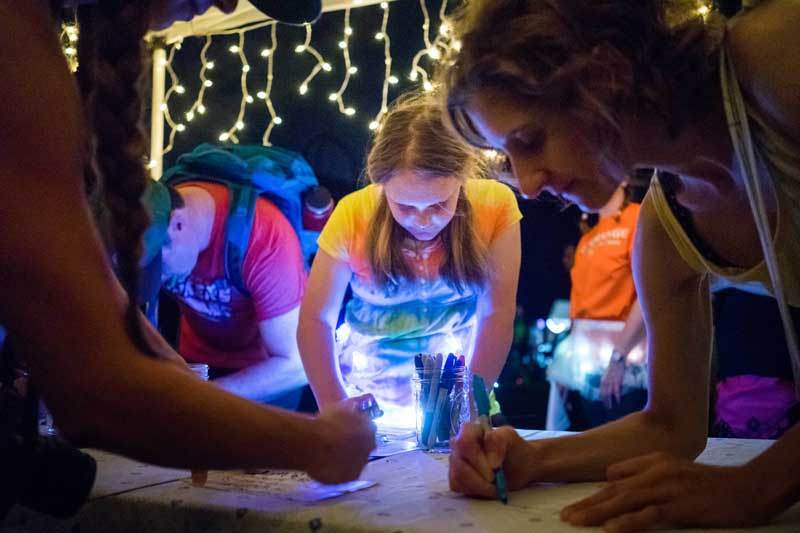 "People wrote on white flags as part of the piece ""Surrender: What are We Willing to Lose?"" during the 2016 Northern Spark Festival. Photo by Annabelle Marcovici"