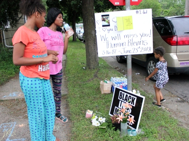 """A sign at 48th & Camden expresses love for the late Thurman Blevins, a """"#1 dad."""""""