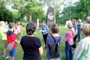 Katie Thornton (center), a guide at Lakewood Cemetery, leading a tour on June 13.  Photo by Austen Macalus