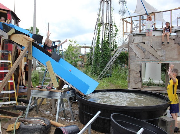 "Kids try out their new waterslide and sit on a ""headless Trojan horse"" at Adventure Playground."