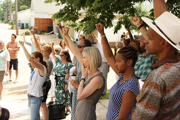 About 50 people gathered at a rally June 15 at 51st & Washburn. It was the same site were Justine Damond was shot and killed by a Minneapolis police officer one year earlier. Photo by Dylan Thomas