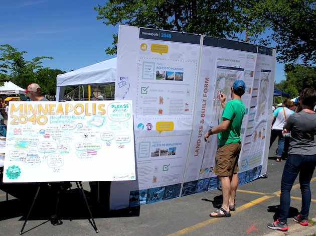 Linden Hills Festival-goers write feedback on the city's proposed long-range plan.