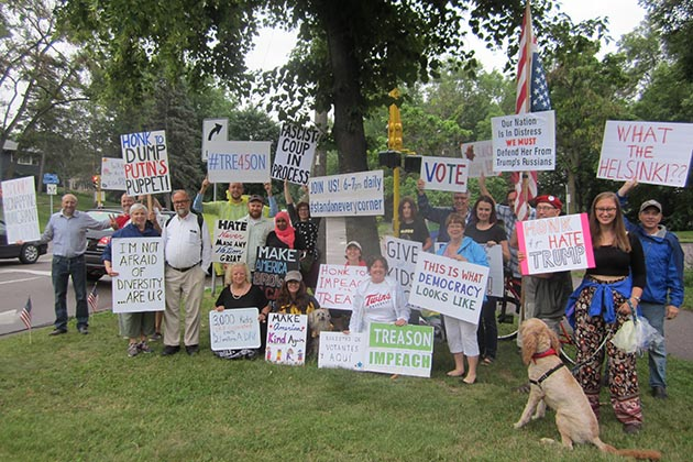 """We're patriots!"" yelled one of the Trump protesters during this group photo shoot on the evening of July19. The protesters have taken to the corner of Diamond Lake & Portland every evening for a month and plan to continue until Election Day. Photo by Jim Walsh"