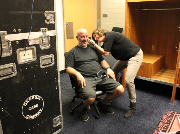 "Kim Fishman takes custom ear impressions for Scott, who mixes sound on the Zac Brown Band tour. He uses inner-ear monitors, which he describes as ""earbuds on steroids."""