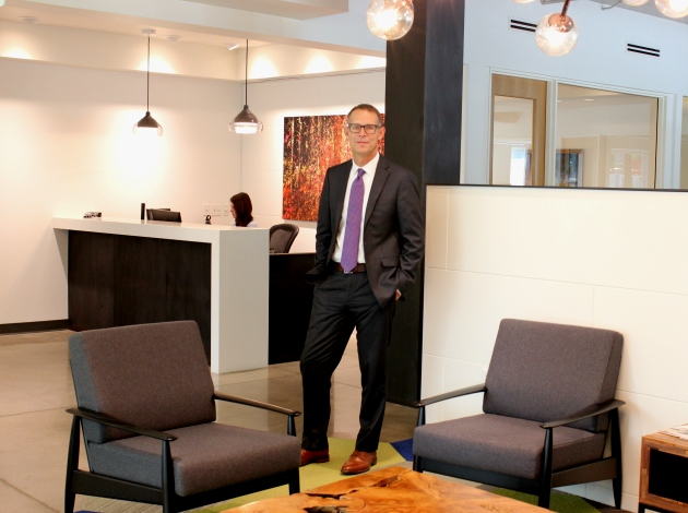 Attorney Daniel Brazil, pictured at his firm's new office on West Lake Street.