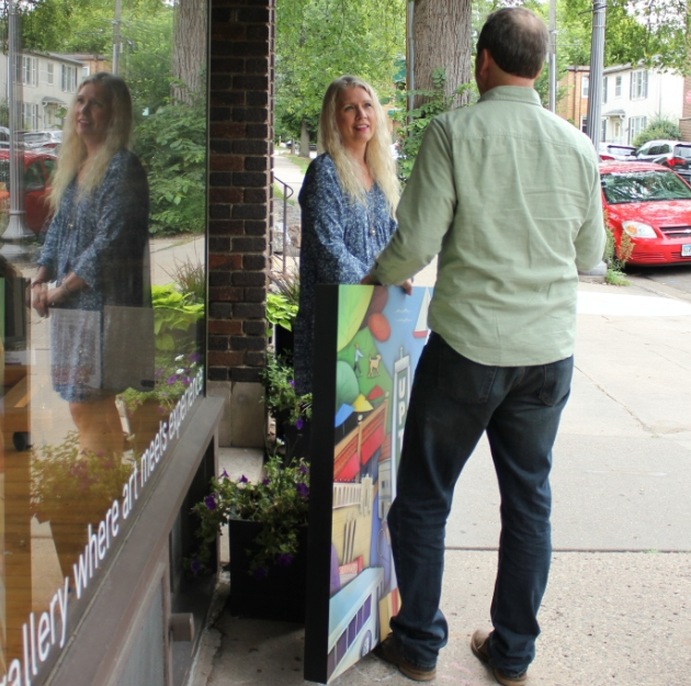 Suzie Marty, owner of Everett & Charlie, talks with artist Brian Jensen, the 2018 Uptown Art Fair featured artist.