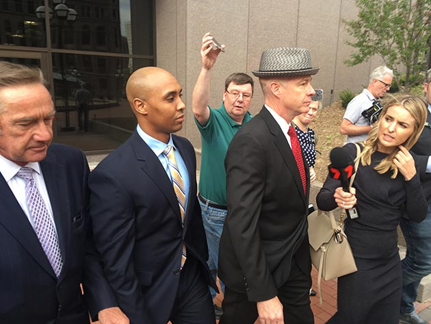 Former Minneapolis police officer Mohamed Noor leaving the courthouse after entering a not-guilty plea in May. Noor was escorted by defense attorneys Peter Wold, left, and Tom Plunkett, right. Photo by Dylan Thomas