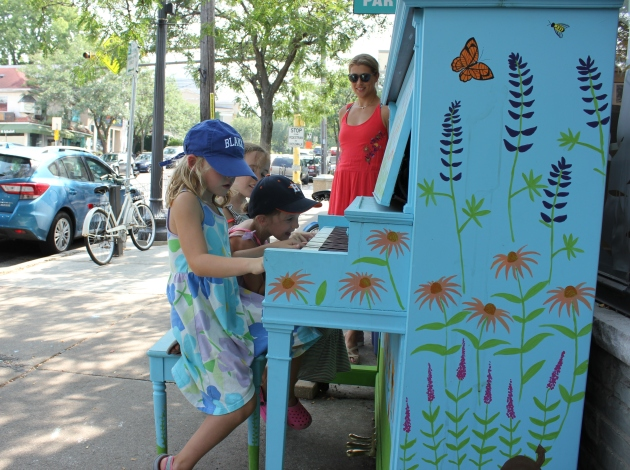 Lucy Rahn and campers with Lucy's Outdoor Dance Camp play the piano in Linden Hills. Rahn said the piano reminds her of outdoor pianos commonly found in New York.
