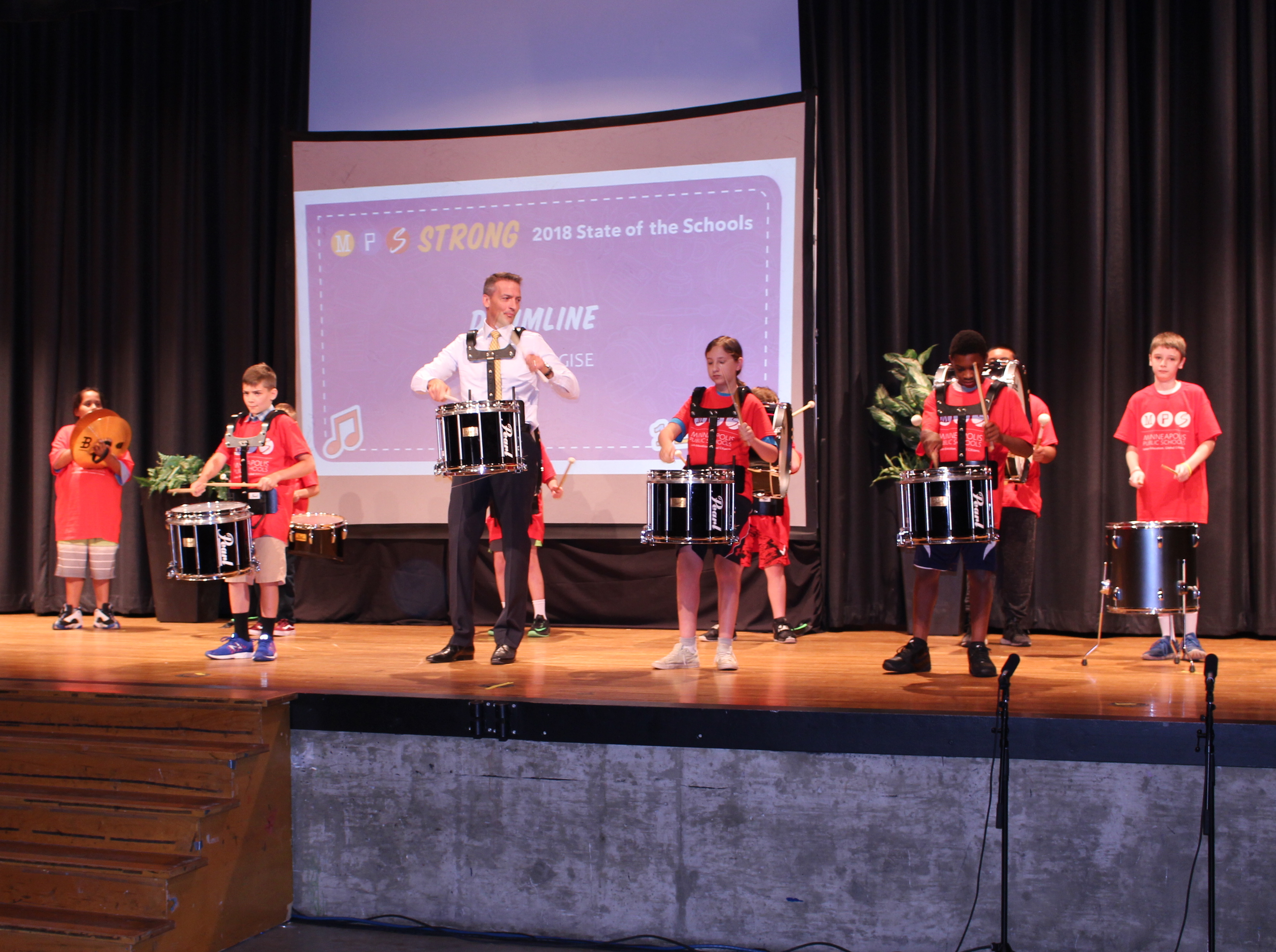 "Graff plays alongside members of the Gems/Gise summer drumline after his ""State of the Schools"" speech Monday."
