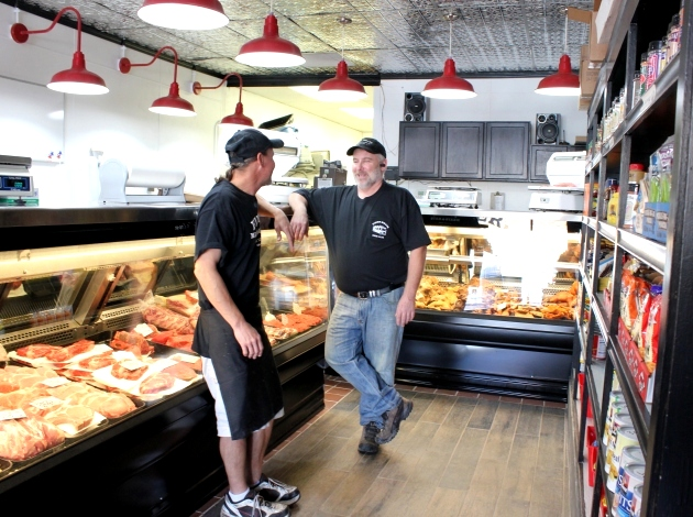 Reopened and renovated, the Finer butcher shop has passed to the next generation. Pictured are Finer Meats & Eats owner Doug Meyer (r) and Brian Knopik.
