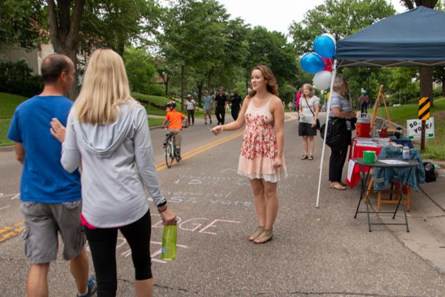 Garfield neighbor Eleni Sophocleus works to get out the vote at Open Streets Lyndale. Photo courtesy of Ann Burns