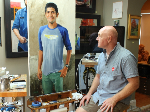 Painter Joe Burns at his Fulton studio with a portrait of Victor.