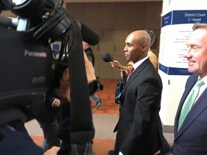 Former Minneapolis police officer Mohamed Noor was surrounded by cameras as he left the Hennepin County Government Center  with his attorneys Thursday. The judge in his murder trial set an April 1 start date for proceedings. Photo by Dylan Thomas
