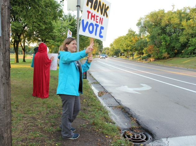 Dana Wabner demonstrates with #StandOnEveryCorner Sept. 17 at East Diamond Lake Road & Portland Avenue.