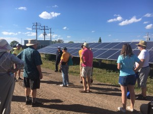 Members of several local Unitarian Universalist churches look at panels during a visit to their solar garden this month. the solar garden to which they subscribe earlier this month. Submitted photo