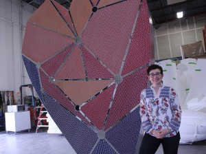 Cedar-Isles-Dean resident Stacia Goodman designed and built a 19,000-tile mosaic heart sculpture for developer Ackerberg's new MoZaic East office building.