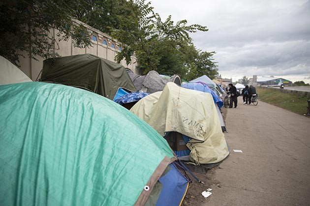 "Also known as ""The Wall of Forgotten Natives,"" the encampment along Hiawatha Avenue has attracted hundreds of people experiencing homelessness since this summer. Photo courtesy Chris Juhn"
