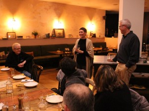 Michelle Courtright, owner of the Uptown vegetarian restaurant Fig + Farro, speaks to attendees of a dinner and climate salon event at the restaurant on Nov. 12.
