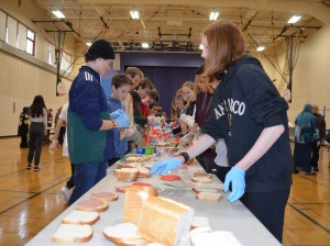 Eighth-graders at Lake Harriet Community School Upper Campus make sandwiches Friday morning  for the 'sandwich man' Allan Law. Photo by Nate Gotlieb