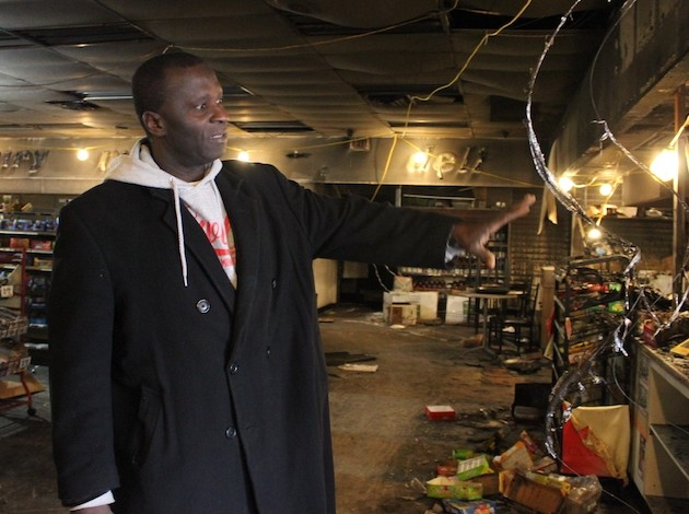 Martin Onuh, owner of CK Food & Fuel, surveys the damage from a Sept. 30 fire.
