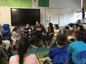 Children's Theatre Company teaching artist Pedro Bayon tells a story to the students in Angela Cruz's third-grade classroom during a Neighborhood Bridges session on Nov. 7 at Jefferson Community School. Photo by Nate Gotlieb