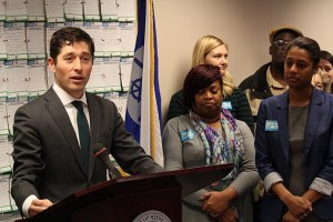 Mayor Jacob Frey was joined at the 2019 budget signing ceremony by members of the Make Homes Happen coalition, including, at right, Miranda Walker, a senior project manager with non-profit affordable housing developer Aeon. Photo by Dylan Thomas