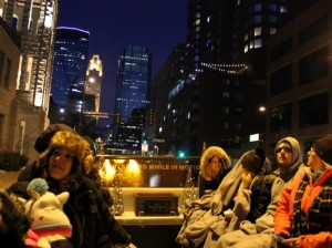 Holidazzle attendees take in skyline views during a sleigh ride through downtown.