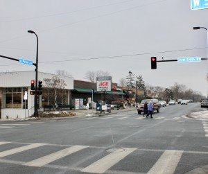 Pedestrians cross the street at the intersection of 54th & Penn, a busy business district at the convergence of three Southwest neighborhoods.  Photo by Andrew Hazzard.
