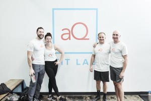 AQ Fit Lab owners Logan Bautch and Anne Mezzenga, left, and Mark and Tim FunkMeyer, stand in the entryway of their new gym at 44th & Drew. Submitted photo.