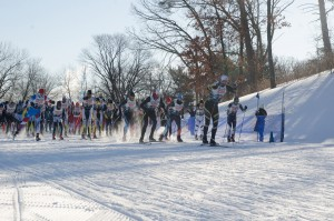 Racers take off at the start of the cross-country ski skate -style marathon in 2018 at Theodore Wirth Park. This year the racers will start at Bde Maka Ska and ski north toward The Trailhead. Photo by Daniel Johnson.