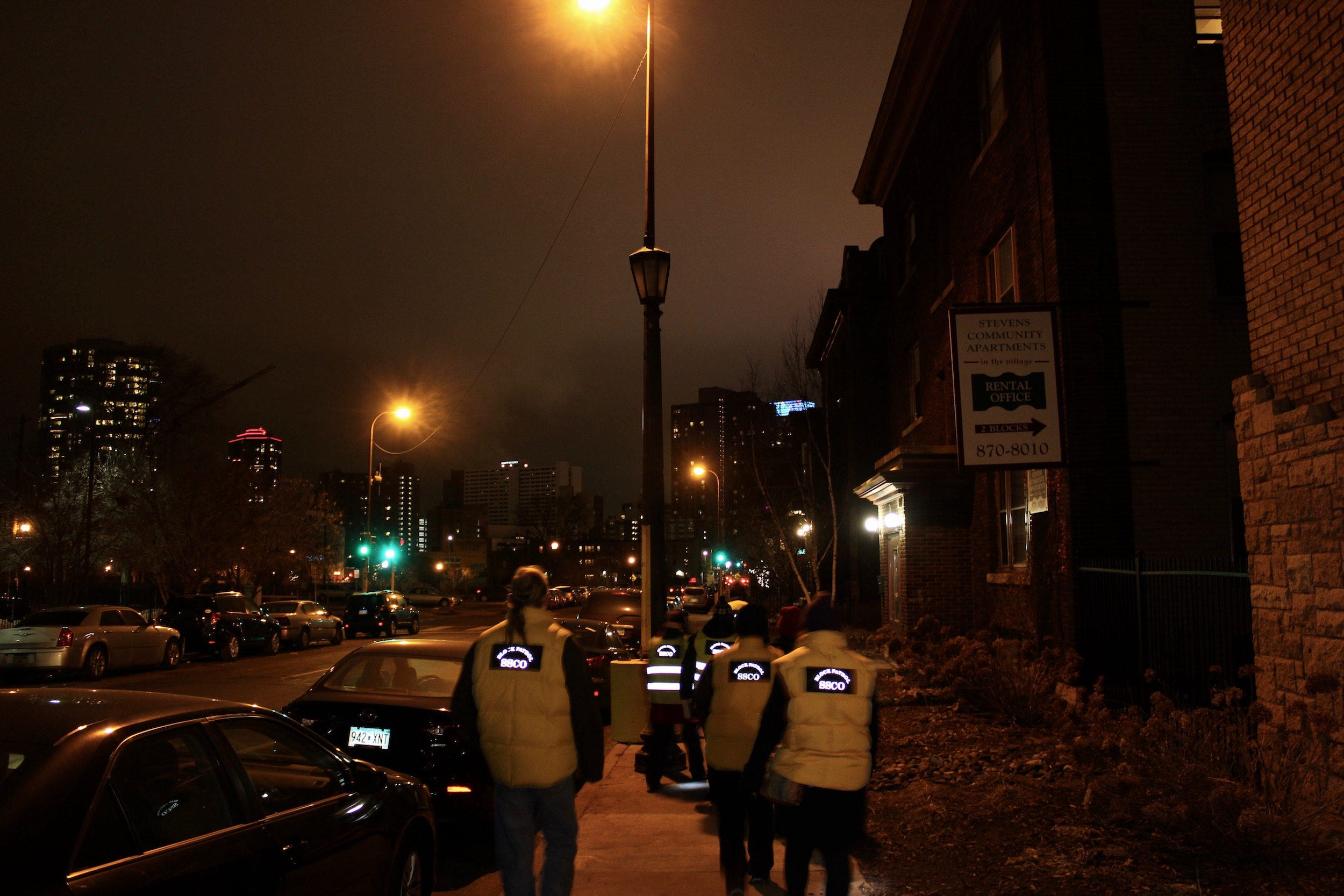 Stevens Square residents conduct a survey of non-working street lights on Jan. 14.  Photo by Andrew Hazzard.