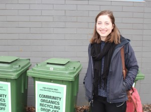 Katlyn Flannery stands next to the community organic recycling bins at The Wedge Co-op. File photo.