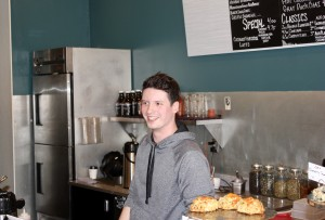 Zoe's Cafe owner Jack McCrery works behind the counter at his new coffee shop in Uptown. Photo by Andrew Hazzard.