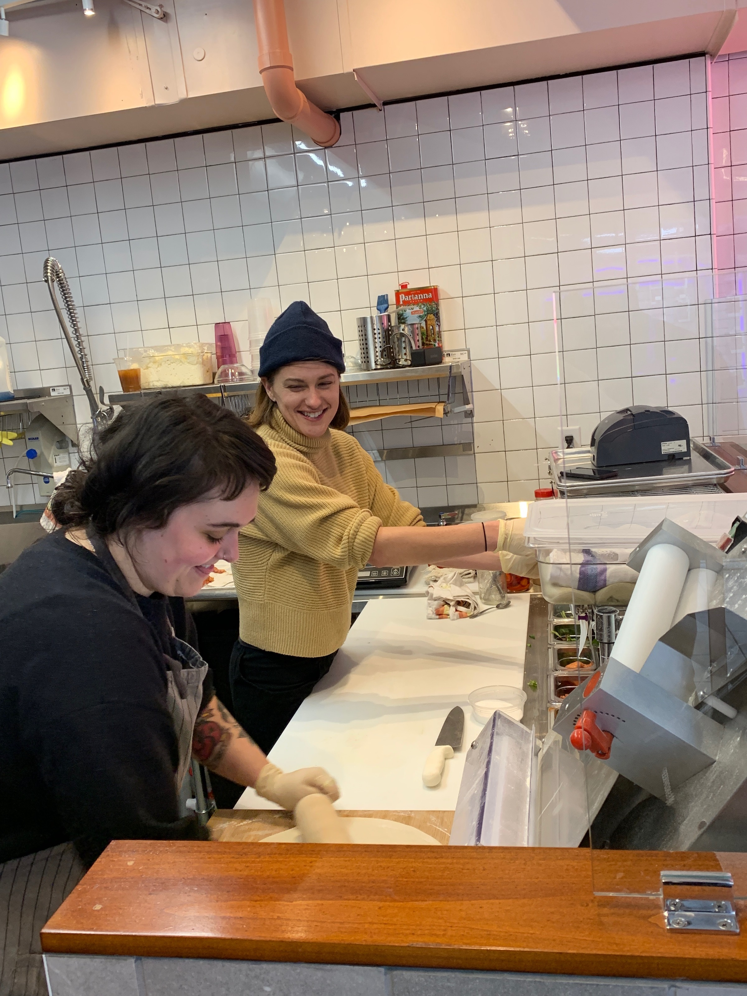 Sophia Munch, left, and Paige Alexander prepare  a flatbread sandwich at Zettas on 24th & Nicollet.  Photo by Andrew Hazzard.