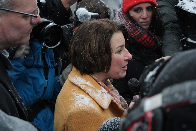 Surrounded by a scrum of local and national reporters after the rally, Klobuchar responded to a question about her management style. Photo by Dylan Thomas