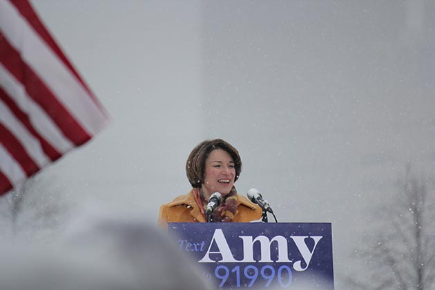 Snowflakes piled up on U.S. Sen. Amy Klobuchar and a crowd of hundreds of supporters who showed up at Boom Island Park for the official launch of the Democrat's 2020 presidential campaign. Photo by Dylan Thomas