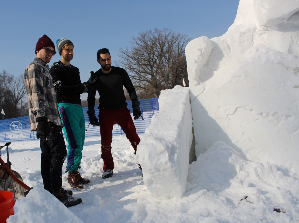 "Tyler Govek, Dallas Erdahl and Thomas Bales (from left to right) create a snow sculpture during the Southwest Journal snow sculpture contest Feb. 2 at Theodore Wirth Park. The team created a sculpture of an octopus called ""Frozen Fingers."" Photo by Nate Gotlieb"