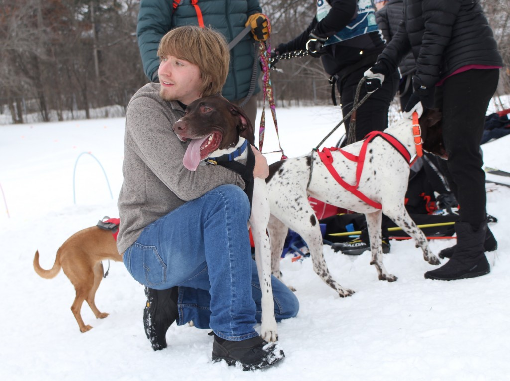 Braden Estenson of Eagan holds his sister's dog before the start of the Chuck & Don's Skijoring Loppet and One-Dog National Championship Feb. 2 at Theodore Wirth Park. Photo by Nate Gotlieb