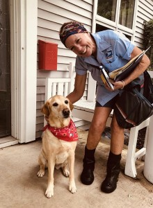 Pauline Pepper with Cali, one of the dogs on the Linden Hills mail route she has walked for 37 years. Submitted photo