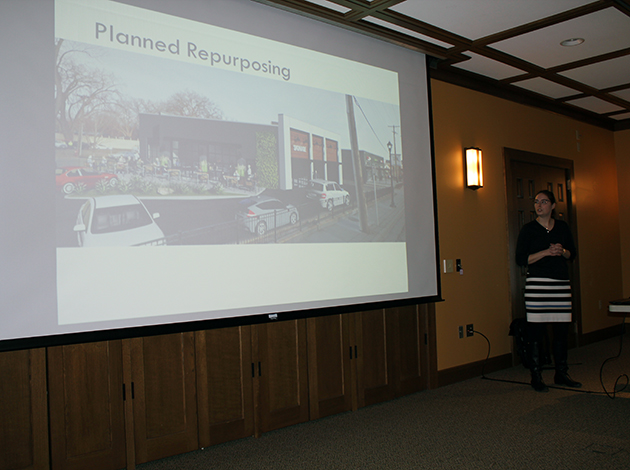 Nolan Properties development analyst Kim Van Dyn Hoven presents a plan to fix up a former Jiffy Lube site to the West Calhoun Neighborhood Council on Tuesday. (Photo by Zac Farber)