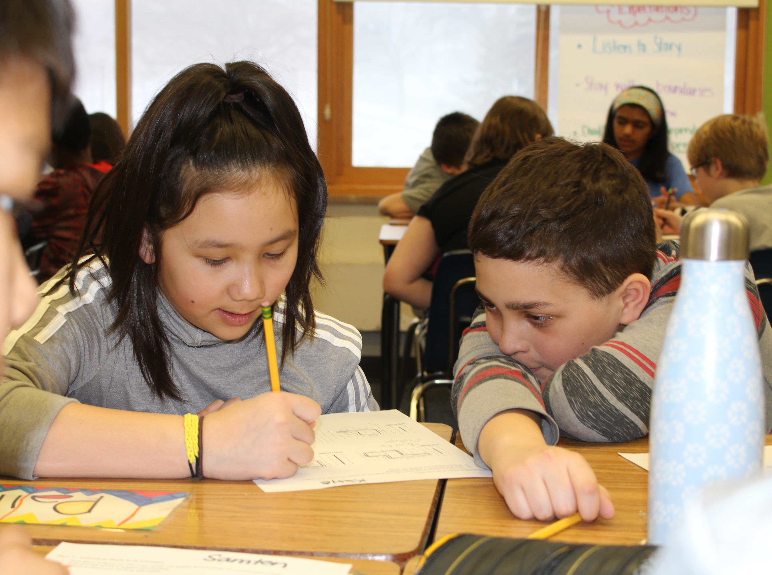 Students in Rivard-Johnson's class work together to solve a worksheet during a recent math lesson. Photo by Nate Gotlieb
